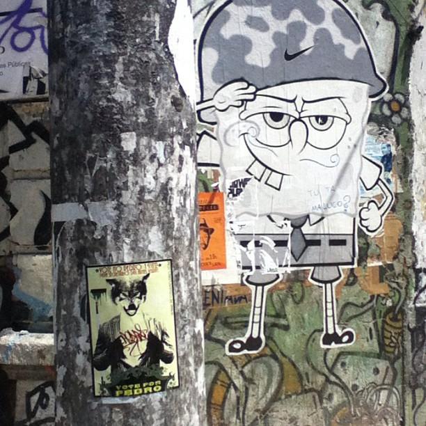 Another #voteforpedro #sticker right by a really cool #nike #military #spongebob #wheatpaste piece in the #Lapa #Rio district. Anyone know the spongebob artist? #urbanart #streetart #streetartrio #art #stickers #stickerart #stickerporn #petervanflores #pasteup #brasil #brazil #riodejaneiro #spongebobsquarepants #justdoit