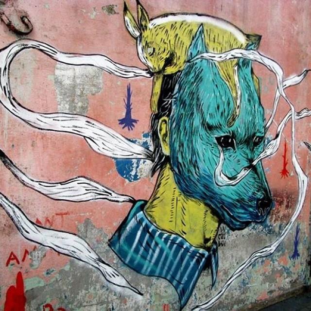 #StreetArtRio #rio #riodejaneiro #mural #nicolaeNegura #cucubau #art #colors. #Wolf #rabbit. #rodoviaria
