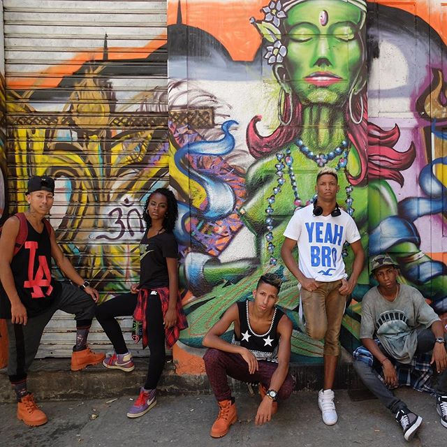 Passinho dancers posing in front of a mural by Irak and Verd and Pânico in Lapa in Rio de Janeiro, Brazil. Cool!