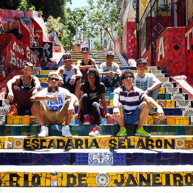 Passinho dancers resting on the Escadaria Selarón Steps in Lapa in Rio de Janeiro, Brazil. Colorful mosaic!