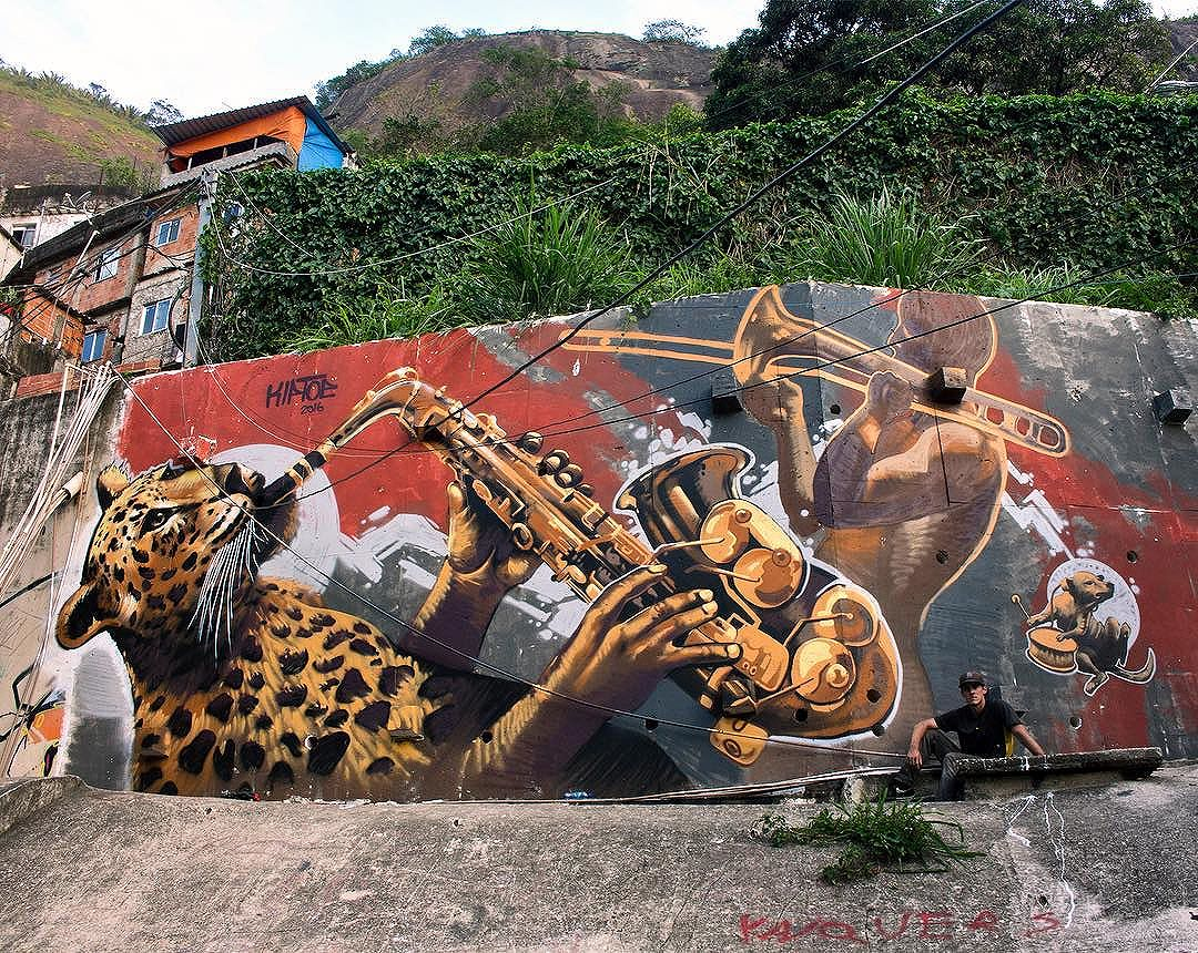 """""""Samba Sparks"""" - my mural in #Rocinha the largest favela in Brazil. Amazing to paint here. You can see this mural from the ground and across the favela. Such a pleasure to leave it here in Rio. Thanks to Reuben Rankin for the spot!  #southamericankiptoe #travelingartist"""