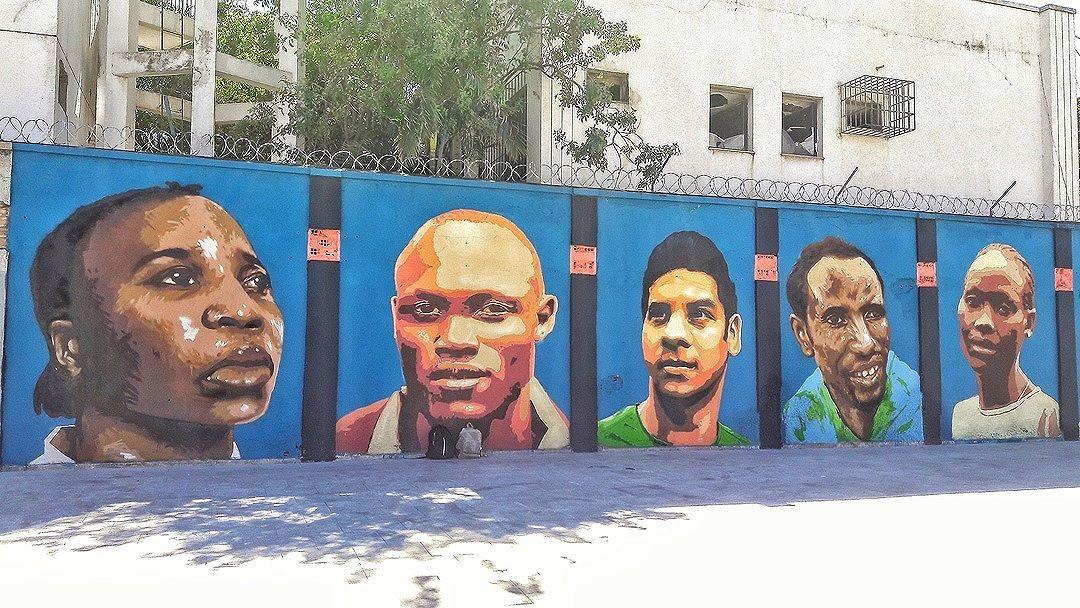 #StreetArtRio  Equipe dos Refugiados da Olimpíada de 2016. Grafite no Boulevard Olímpico, na Gambôa. 1/3 Artistas: Rodrigo Sini (@rodrigosinirodrigosini) e Cety Soledade (@cetysoledade) Tirada em 26/08/2016 ____________________________________  Quer conhecer mais obras destes artistas e de tópicos relacionados? Explore mais em: #g021_rodrigosini #g021_cetysoledade