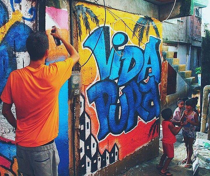 Great photo taken by one of our artist #puravida #vidapura #streetart #grafite #graffiti #colours #vibes #rio #macega #rocinha #favela #favelas #barrio #streetart #streetartrio #arte #rioarte #punkyreggaeparty #dope #vibes