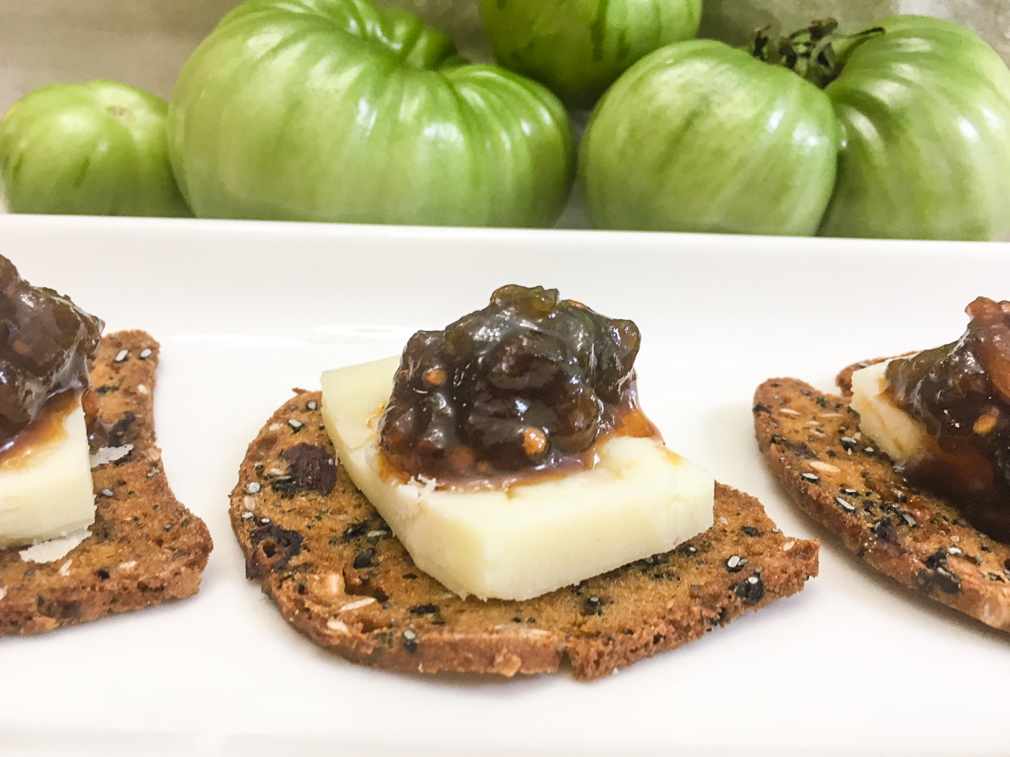 Mmm! Green tomato marmalade atop manchego cheese and crackers.