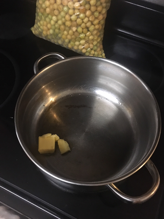 Start with some butter in your pan to keep the berries from sticking and to add some additional creaminess to the final flavor of your ground cherry preserves. You'll also add a little water to help prevent fruit scald, as the recipe instructions below indicate.