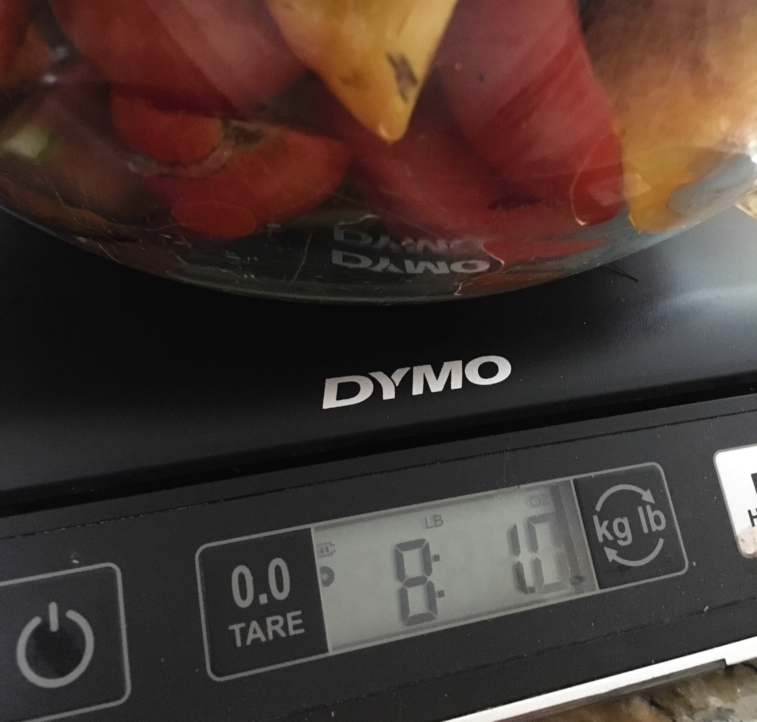 Bowl of chopped tomatoes on the Dymo scale. The bowl weighed 2lb 1.56oz and I forgot to TARE it before measuring, which would have made it easier to weigh only the tomatoes, not the bowl too. What percent of a tomato is water weight?
