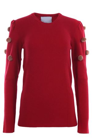 Crew neck with applied pom pon