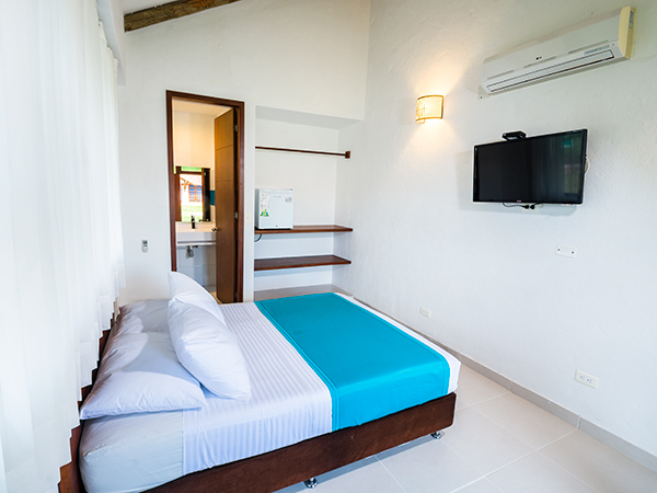 Habitaci n est ndar doble en brizantha hotel campestre for Habitacion familiar estandar