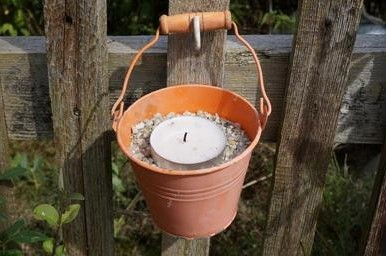 citronella candle in a bucket