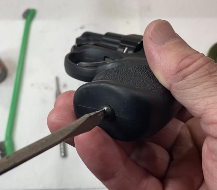 Remove the Grip screw