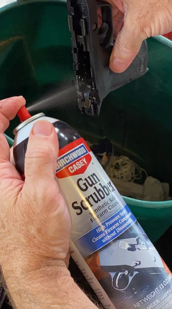 Use Birchwood Synthetic Safe Gun Scrubber to clean the Frame.