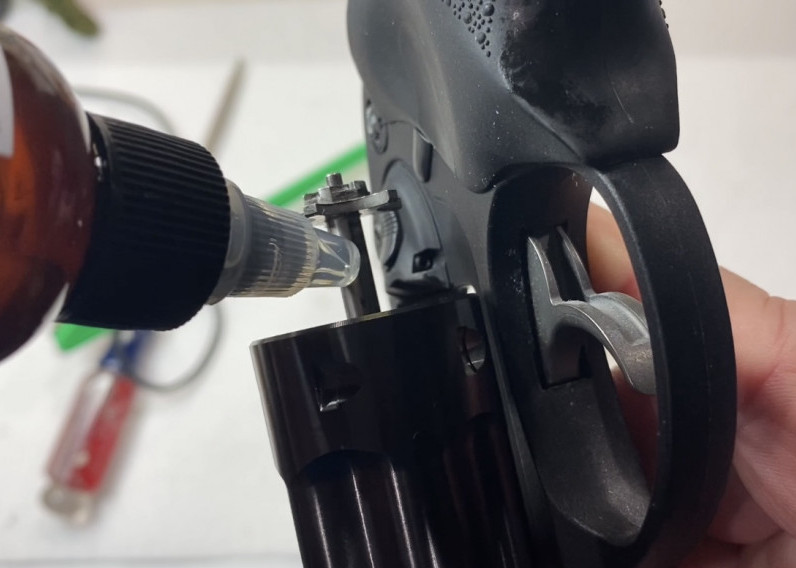 Press on the ejector rod so it extends as shown. Apply a drop or two of Gun Oil to the ejector rod