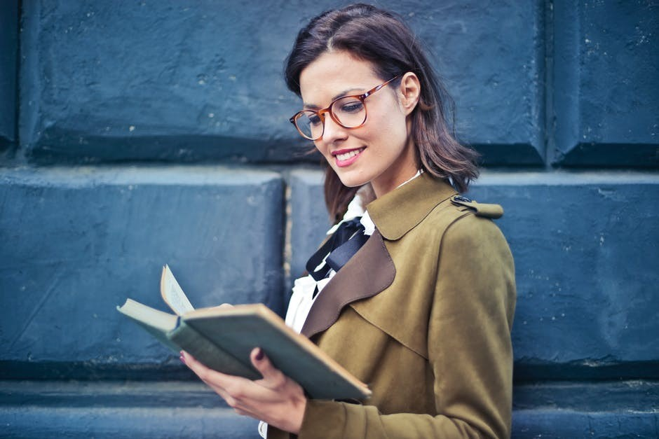 Woman Reading About Making Money