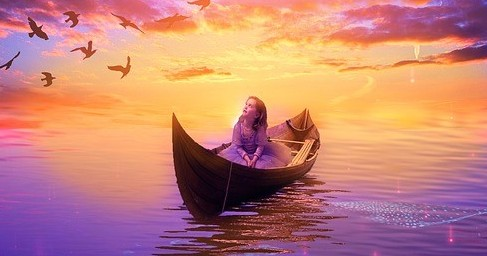 photo of a woman in a small boat looking at birds