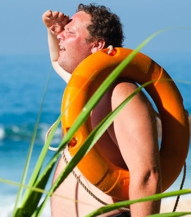 photo of a man at the beach searching for someone