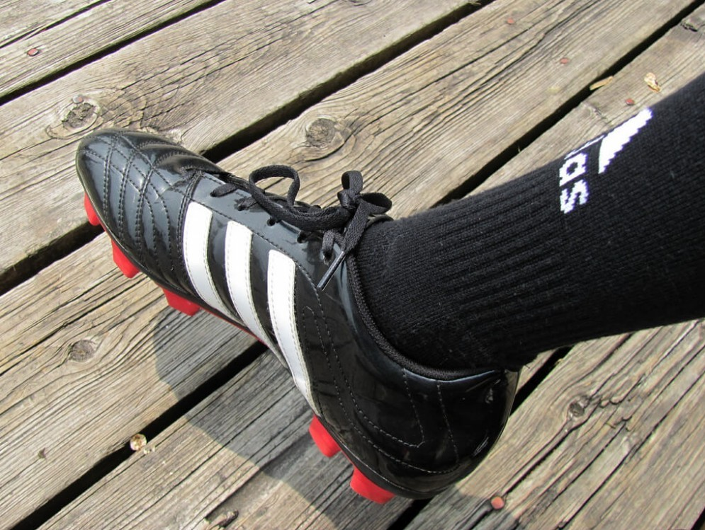 Black fitted adidas soccer cleat