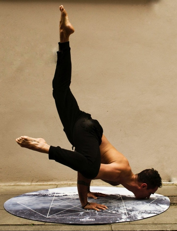 man doing a yoga position on his hands and mouth