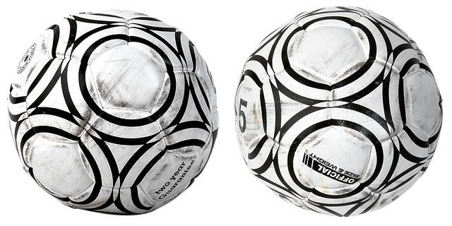 2 worn soccer balls
