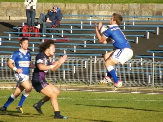 full back shuan foley catching the rugby ball in the air