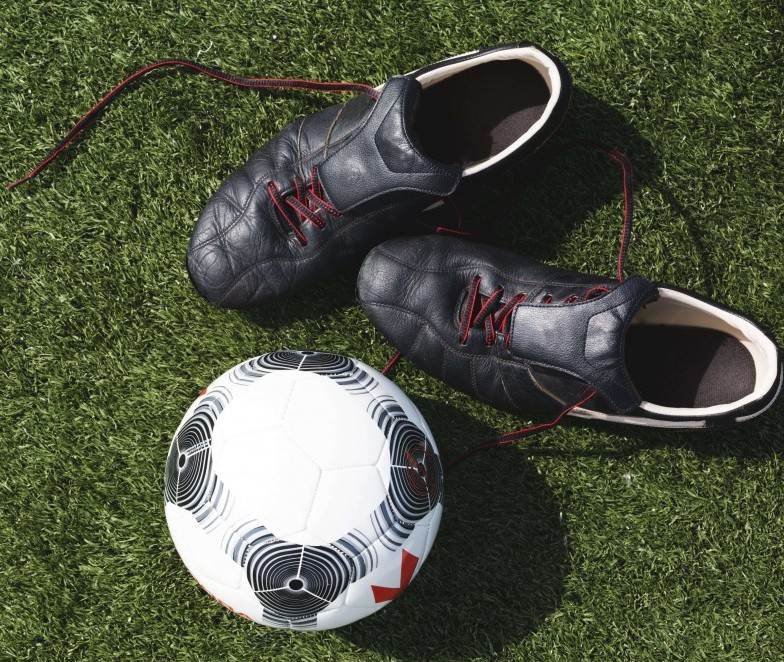 Soccer cleats and soccer ball