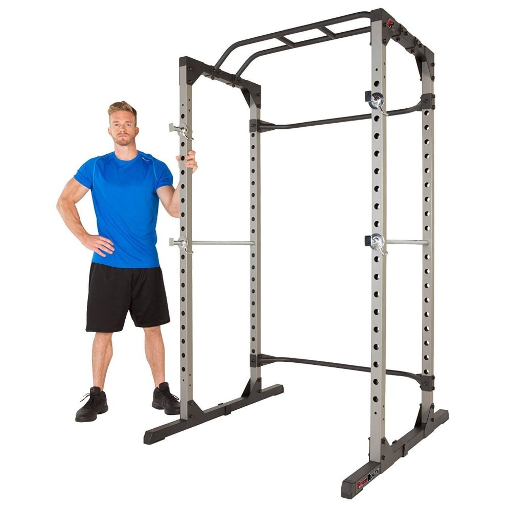 Man standing next to the Fitness Reality 810XLT Super Max Power Cage