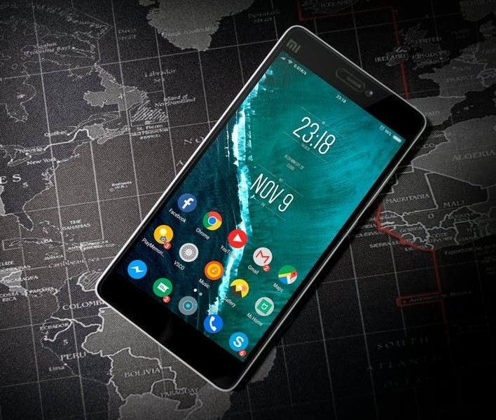Mobile phone with applications above a map of the world