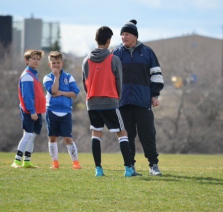 soccer coach talking to one of his players