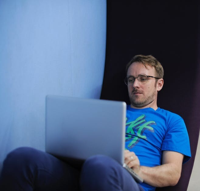 Man Working At Home On The Laptop