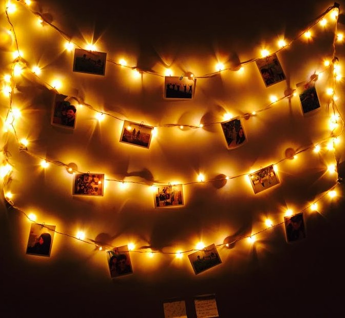 Photos Hanging With Lights All Around Them