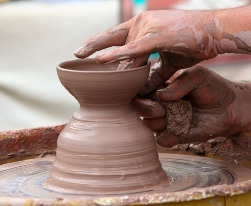 Hands at clay on the wheel - making a dream reality