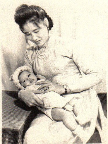 my godmother and me at 2 months old