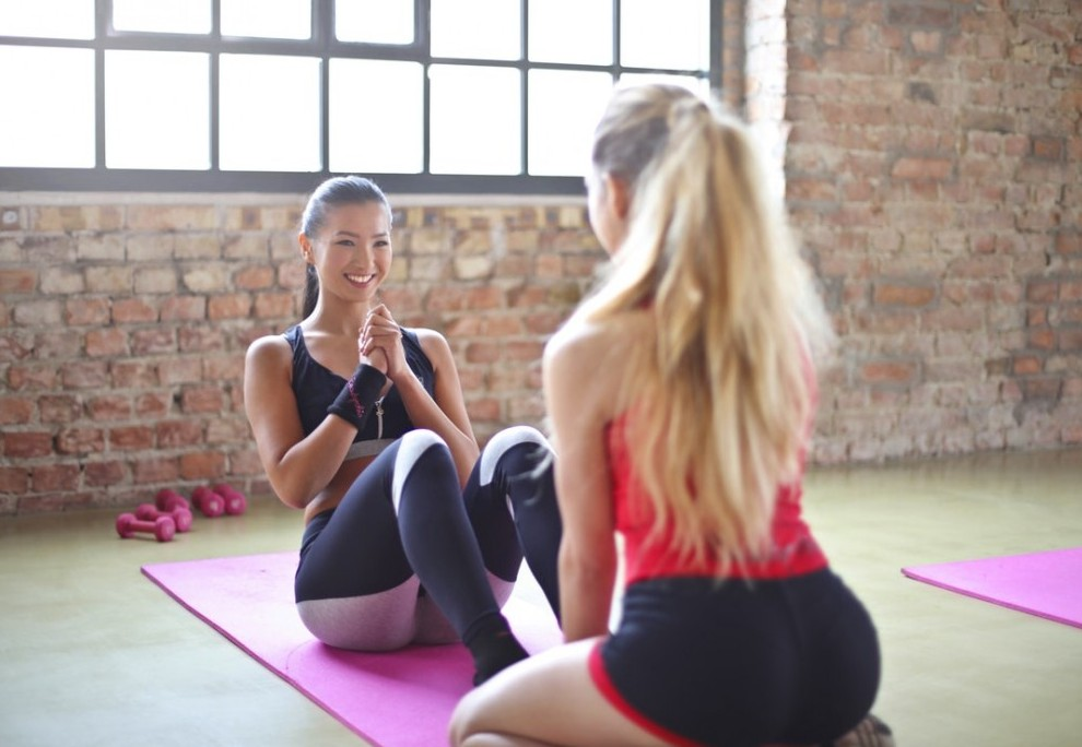 Profitable Online Businesses To Start while 2 woman do sit ups