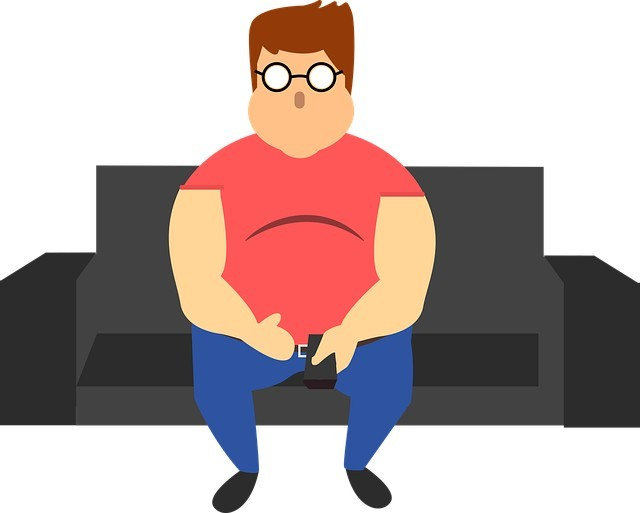 Fat man sitting on couch - betterhumanbeings.com