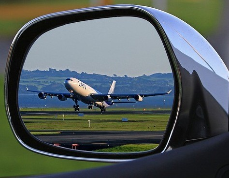 airplane in car mirror