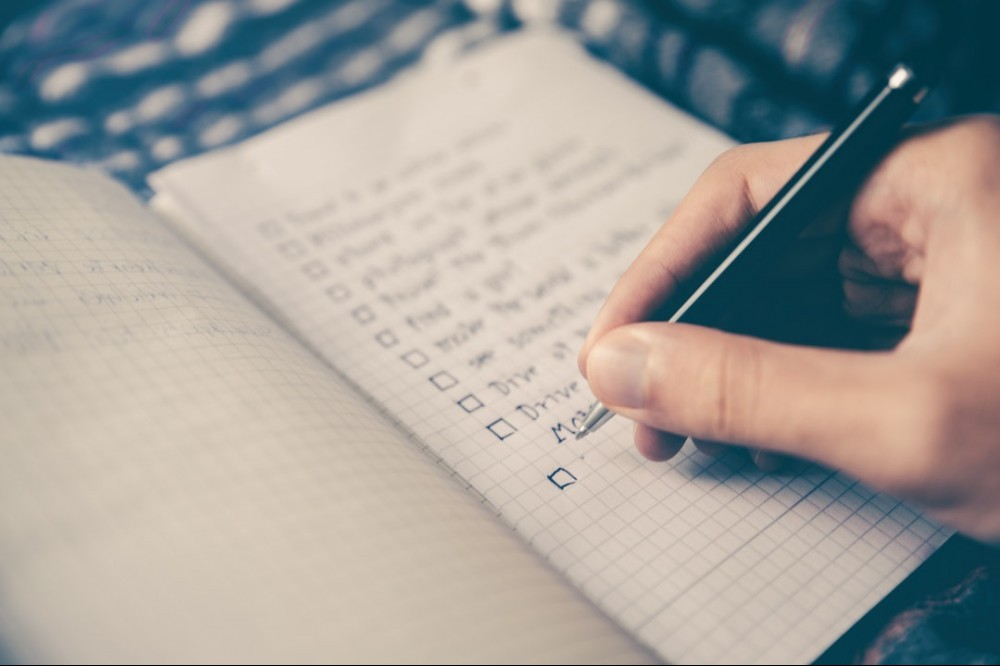 prepare for interview checklist in notebook