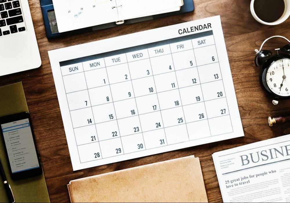 open class slots calendar on desk