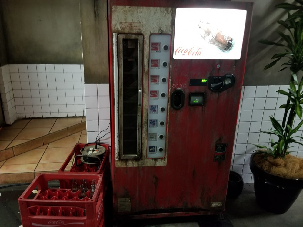 older type of japanese coca cola vending machine
