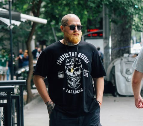 bald man walking