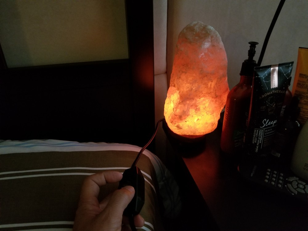 close up view of himalayan salt lamp at my bedside to help me sleep better