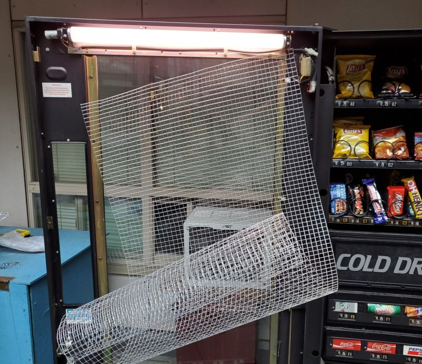 wire mesh on vending machine glass