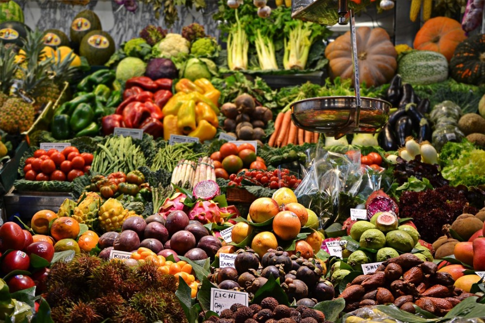Assortment of many fresh vegetables inside of a retail store.