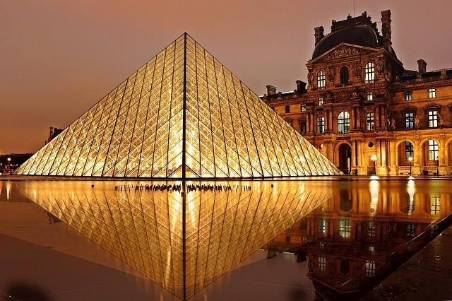 louvre museum in Paris at night