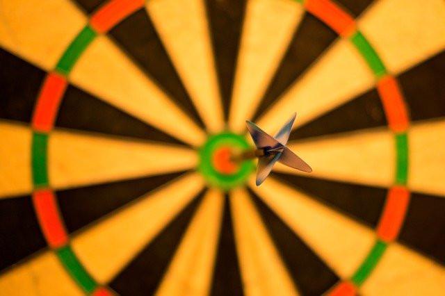 What Is Seo Keyword Research: Photo of dart hitting bullseye