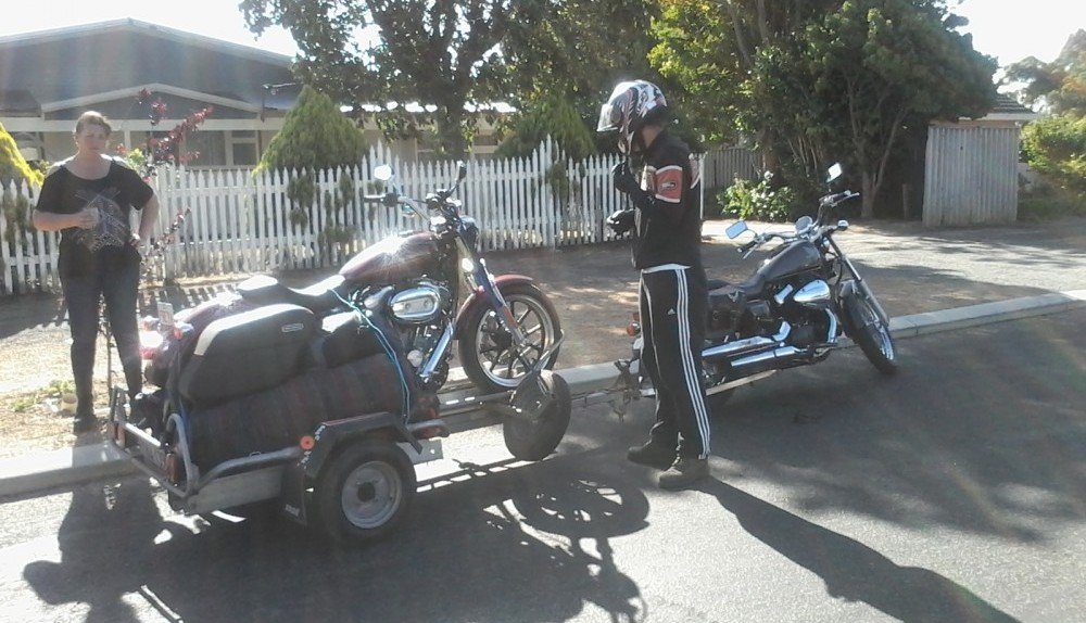 Honda Towing a Harley