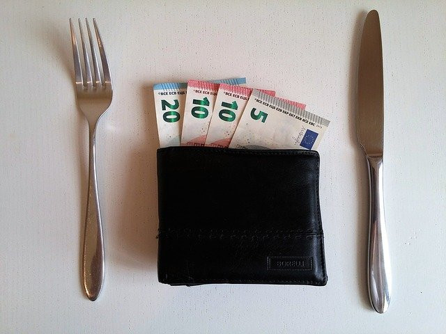 money with knife and fork