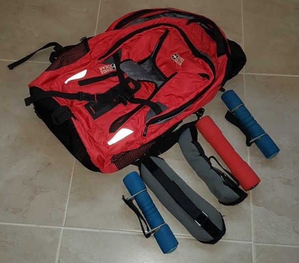 red backpack and 5 x hand weights