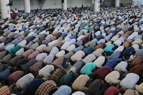 islam believers at prayer in a mosque