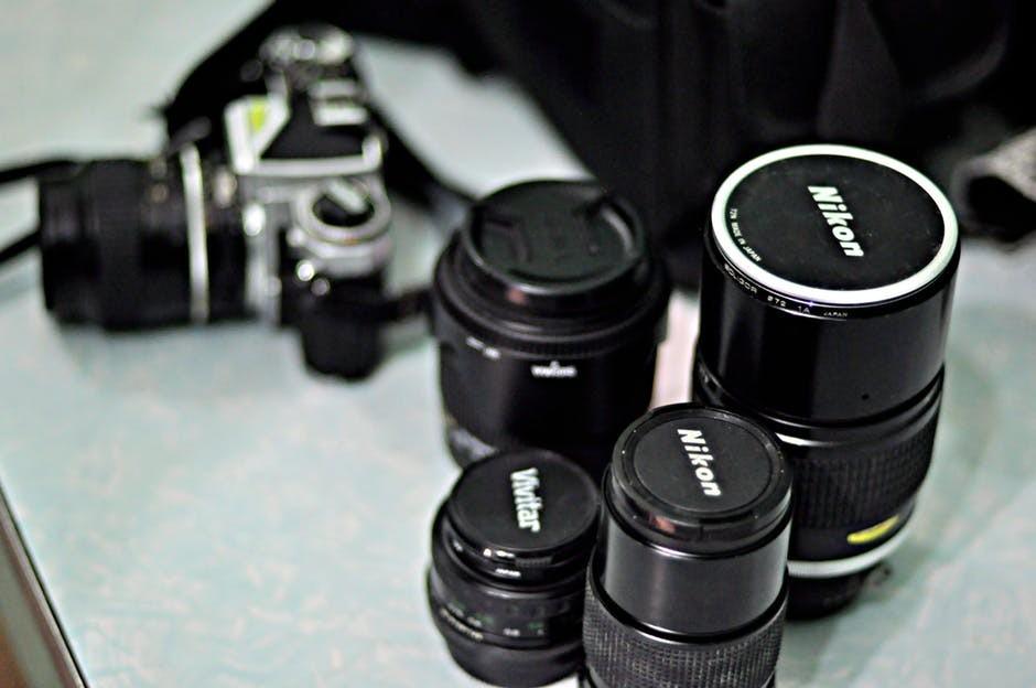 Four Nikon lenses and camera