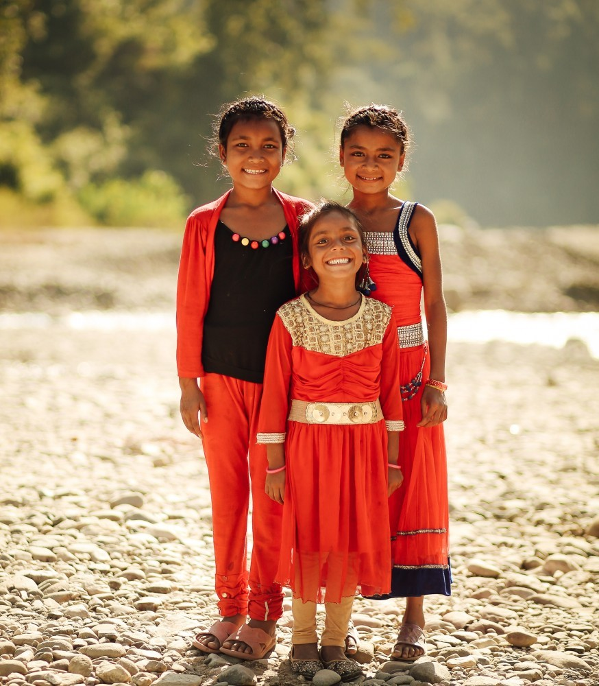 Family portrait of three little girls in red