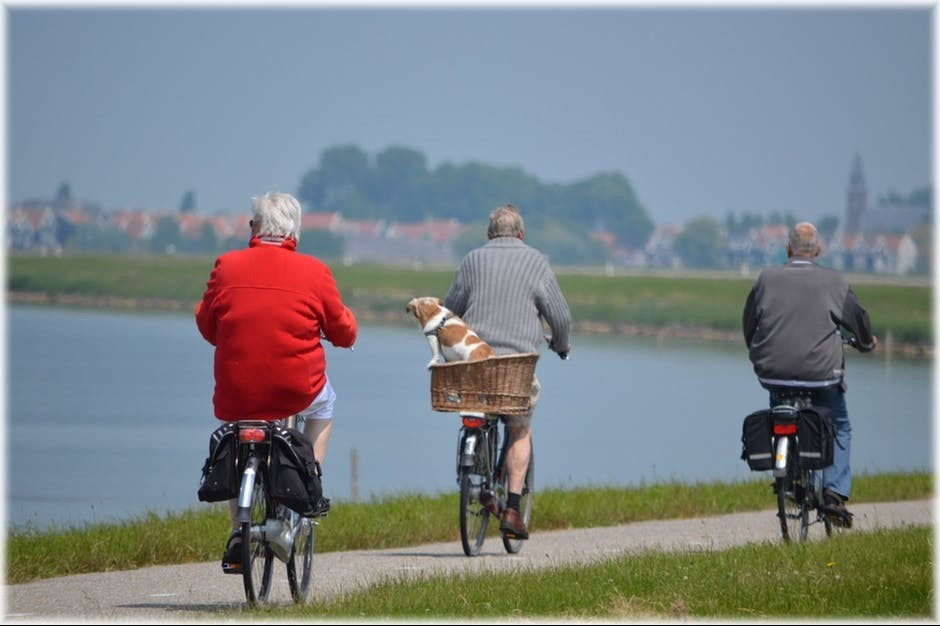 three old people on bikes